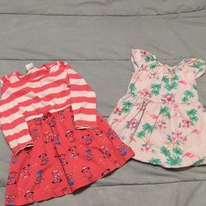 Two toddler girls play clothes dresses